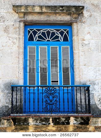 Old typical colonial balcony painted in vivid blue