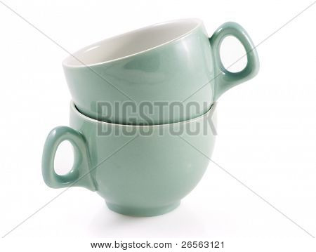 Stack of two green coffee cups in a white background