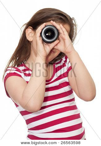 Young girl looking through a camera lens on a white background
