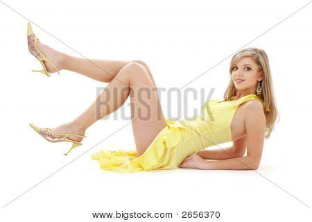 Laying Girl In Yellow Dress