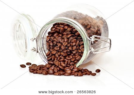 Coffee beans spilling out of a cristal jar on a white background
