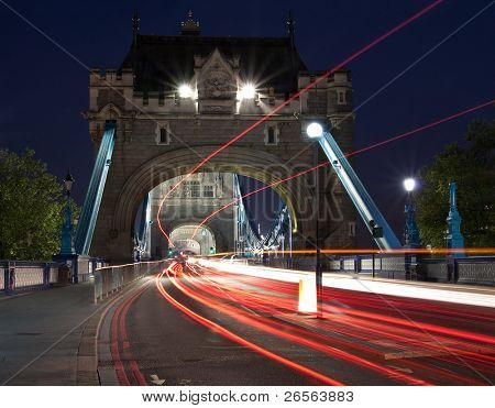 Night scene with traffic light trails in the Tower Bridge in London