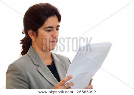 A serious female latin business woman  reading some papers on a white background