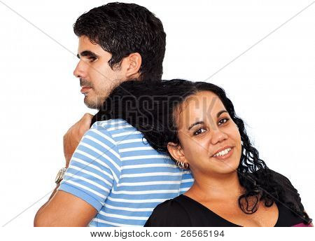 Young latin man grabbing a beautiful  woman by her hair isolated on white