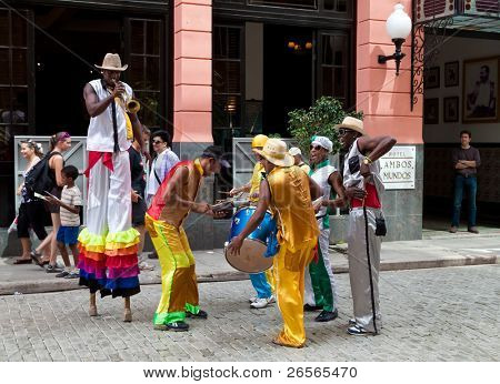 HAVANA - OCTOBER 23: Street entertainers in Old Havana October 23, 2010 in Havana. In the last decade Old Havana has been part of a restoration process to preserve the spirit of the colonial city.