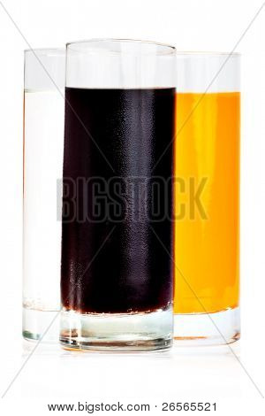 Three soft drinks in highball glasses isolated on white with clipping path