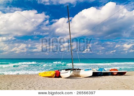 Recreational renting boats landed on the shore of the beautiful cuban beach of Varadero