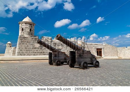 Ancient cannons and an old castle in Havana, Cuba