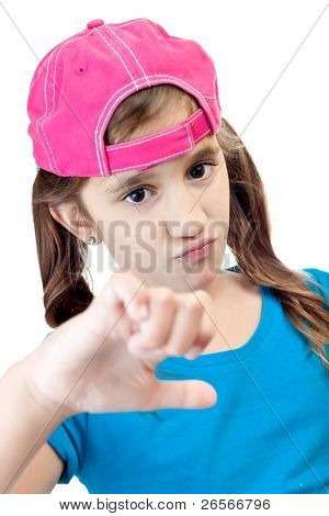 Girl wearing a backwards baseball cap doing the thumbs down sign isolated on a white background