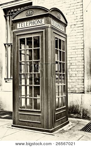 Vintage sepia image of an  iconic London phone booth