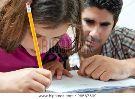 Young father helping her daughter with her school project at home