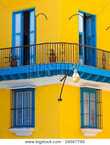 Detail of a restored colonial building in Old Havana with typical caribbean doors and balconies
