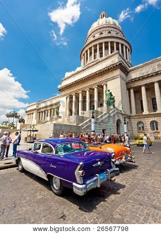 HAVANA-MAY 3:Classic cars in front of the Capitol May 3,2011 in Havana.Cubans keep thousands of them running even when parts have not been made for decades and they've become an icon of the country