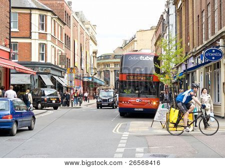 OXFORD,UK-MAY 3:Urban view with typical black cabs and an Oxford Tube bus May 3,2011 in Oxford.The Oxford Tube buses offer free wifi internet access and 240V mains power point onboard every coach