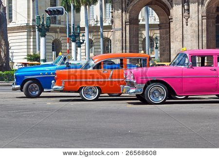 HAVANA-JULY 6:Old cars near the Capitol July 6,2011 in Havana.Under the current law that the government plans to change before 2012,Cubans can only buy and sell cars that were on the road before 1959