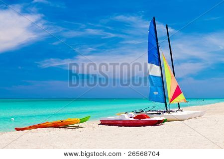 Sailing boats, catamarans, kayaks and water bikes in the beautiful cuban beach of Varadero