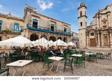 HAVANA-AUGUST 12:Tourists at a restaurant near the Havana Cathedral August 12,2011 in Havana.Tourism has become one of the main source of income for the country with over 2 million visitors a year