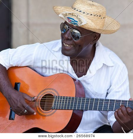 HAVANA-AUGUST 12:Street musician August 12,2011 in Havana.With Cuba receiving over two million tourists a year people like these,usually working for tips;are part of the atmosphere of Old Havana