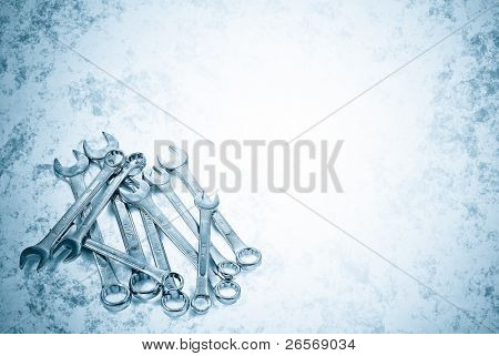 Metallic blue  image of a set of spanners with space for text
