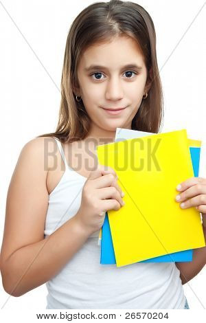Cute girl holding some colorful books isolated on white with space for text