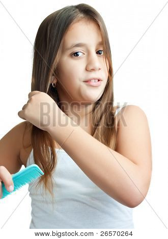 Beautiful hispanic girl combing her hair isolated on a white background