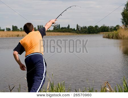 Big man fishing on the lake