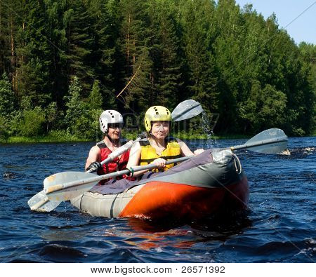 Kayakers sporting a kayak cuts through water