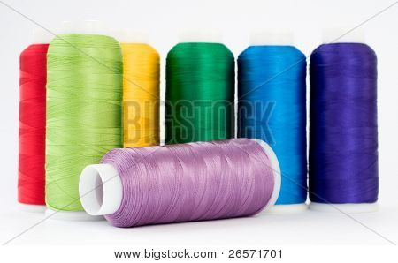 Hanks of multi-coloured threads for embroidery