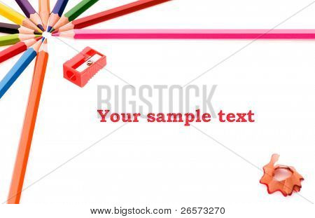 Frame made of colorful pencils, shallow depth of field with focus on the Your text