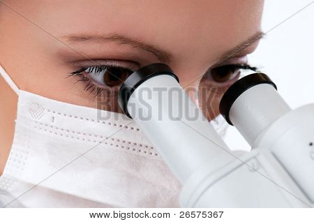 Female medical doctor using microscope in a laboratory on white background
