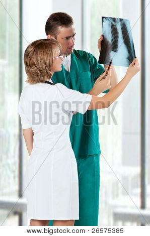 Medical doctors analysing x-ray photography in hospital