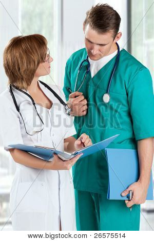 Doctors with file folder and stethoscope in hospital