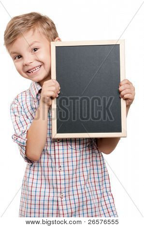Portrait of a little boy holding a blackboard over white background