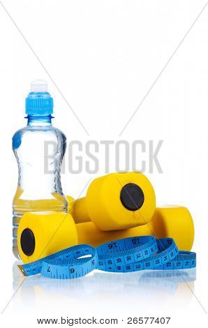 Yellow one kilogram dumbbells with bottled water and measuring tape isolated on white background