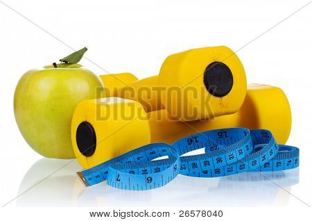 Yellow one kilogram dumbbells with apple and measuring tape isolated on white background