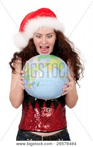 Smiling christmas girl holding globe wearing Santa hat. Isolated on white background.