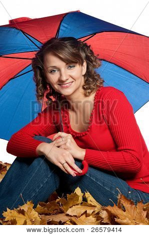 Portrait of a young woman holding an umbrella posing on white
