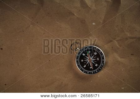 Compass over old grunge paper