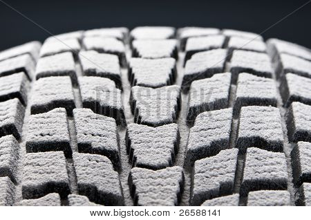 Close-up Detail Of Winter Tire Snowed Tread