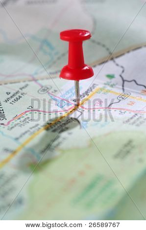 Travel concept with red pushpin