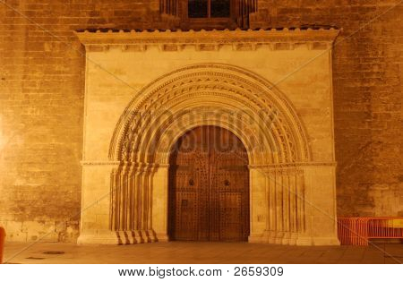 Ancient Gate Into The Cathedral Of Valencia, Spain