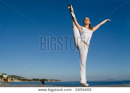 Fit Healthy Young Woman Doing Stretching Exercise