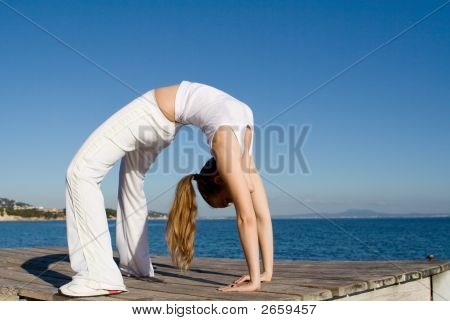 Fit Healthy Young Woman Doing Back Bend Exercise