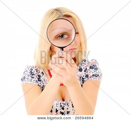 Girl's eye magnified through magnified glass over white background