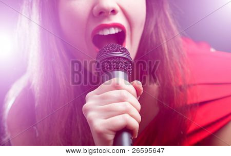 Woman sing over color background. Focused on arm.