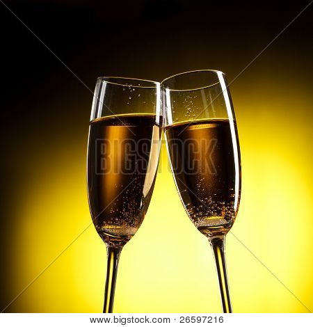 flutes of champagne over yellow background