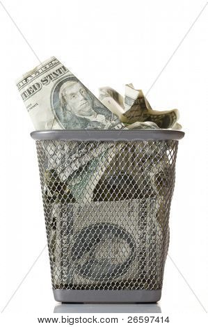 Money in basket. Isolated over white.