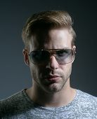 An Intellectual Look. Fashion Model In Trendy Sun Glasses. Man Of Fashion. Fashion Eyewear. Handsome poster