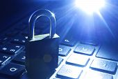 Computer Or Data Analysis - Padlock Over A Laptop Computer Keyboard Toned In Blue. Lock On Computer  poster