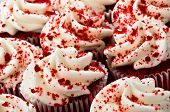 stock photo of red velvet cake  - Multiple Red Velvet Cupcakes Close Together with Sprinkles - JPG
